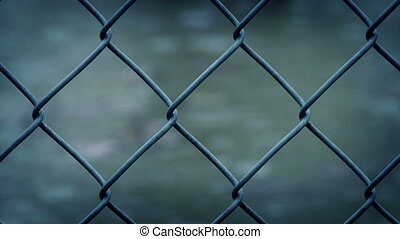 Wire Fence In Rain Closeup - Macro shot of wire fence in...