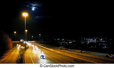 Major Highway At Night With Moon - Highway at night with a...