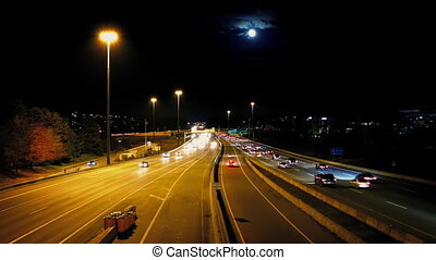 Busy City Road With Full Moon - Highway at night with a full...