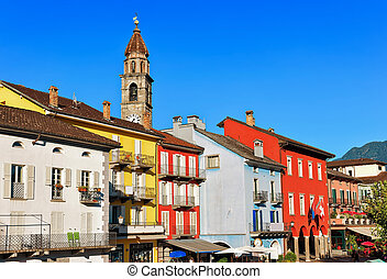 Church tower and facades of buildings in Ascona Ticino...