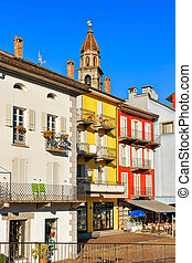 Church tower and facades of buildings Ascona Ticino...