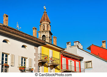 Church tower and facades of buildings of Ascona Ticino...