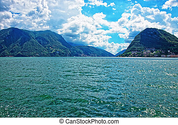 Nature of Lake Lugano and mountains Ticino in Switzerland -...