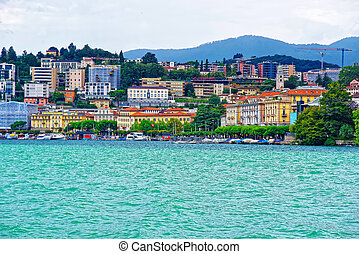 Houses at Lake Lugano and mountains in Ticino of Switzerland...