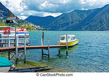 Boat at landing stage in Lugano in Ticino in Switzerland -...