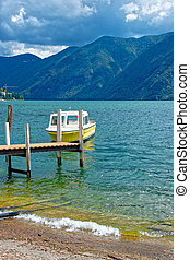 Motor Boat at landing stage in Lugano in Ticino Switzerland...
