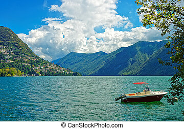 Motor Boat at embankment in Lugano in Ticino in Switzerland...