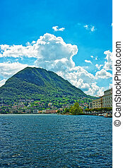 Swiss houses at Lake Lugano and Alps mountains Ticino