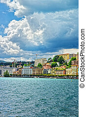 Swiss houses at Lake Lugano and mountains in Ticino...