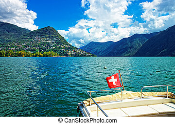 Boat with flag at promenade in Lugano of Ticino Switzerland...