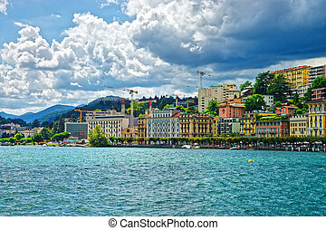 Swiss houses at Lake Lugano and mountains of Ticino...