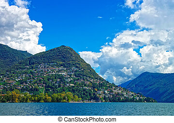 Swiss houses at Lake Lugano and mountains Ticino Switzerland