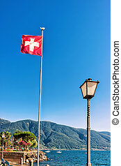 Swiss flag in Ascona in Ticino in Switzerland - Swiss flag...