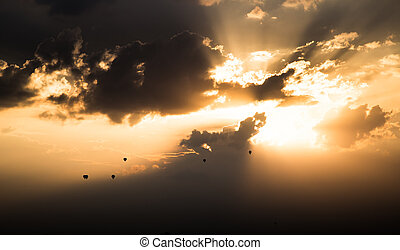Hot air balloons flying in sunset