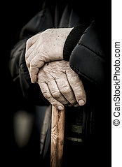 Old people, hands on a cane as main concept