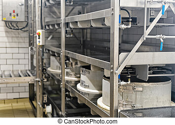 Automated equipment in creamery in Franche Comte France -...