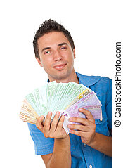 Business man showing handful of money