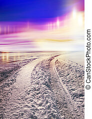 Snow covered road and polar lights - Snow covered road to...