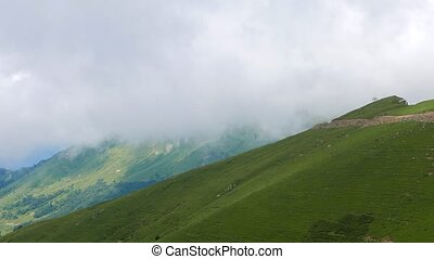 The mountain slopes are covered with forest. Ridge Aibga....