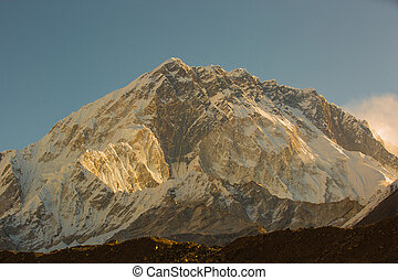 sunrise on snow capped mountain on the way to everest base...