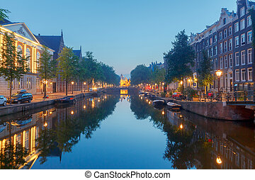 Amsterdam. Night view of the houses along the canal.
