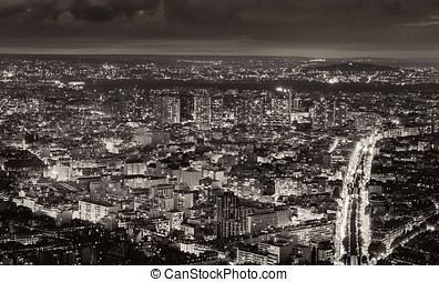 Aerial view of Paris, France at night. Traffic lights in the...