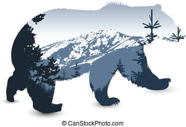bear with panorama of mountains