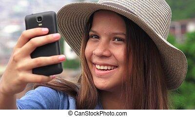 Pretty Female Teen Taking Selfy