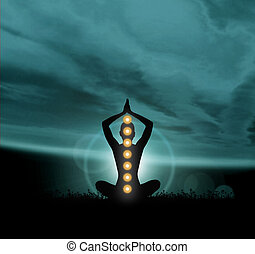 Silhouette of a monk meditating in a lotus position -...