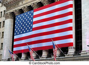 A giant American flag hanging in Wall Street