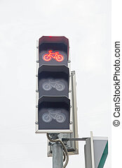red traffic light for bicycles in the city