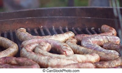 Delicious sausages on grill 4K