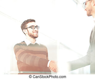 Business man giving a handshake and smiling - Close up of...