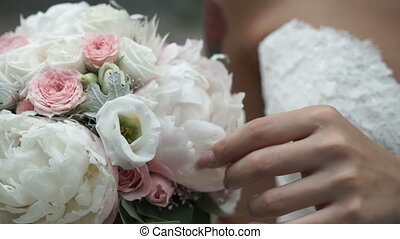Wedding bouquet in hands of the bride close-up.