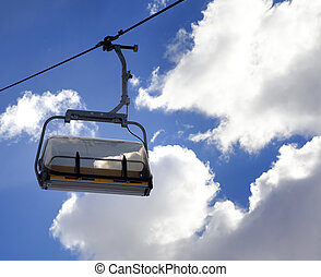 Chair-lift and sunlight sky at winter evening