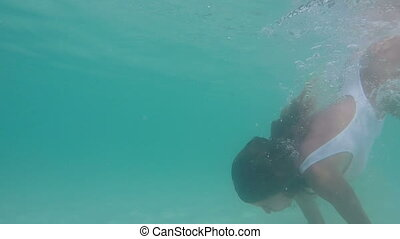 Sexy girl on paradise tropical beach - Underwater shot of...