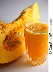 Pumpkin vegetable juice in a glass and cut a piece of...