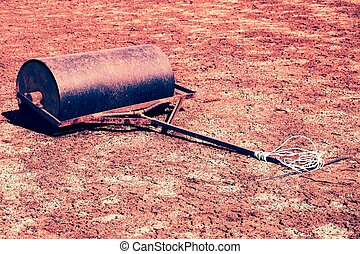 Old rusty iron barrel for maintenance of neglect tennis...