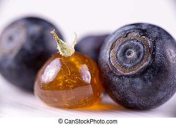 Marijuana oil concentrate aka shatter with blueberries -...