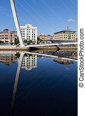 Reflection of the Gateshead Millenium Bridge and Buildings,...