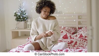 Gorgeous stylish young African woman relaxing at home over...