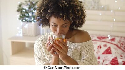 Smiling woman holding hot tea - Close up on beautiful young...
