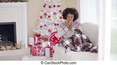 Woman relaxing during the Christmas holiday season - Young...