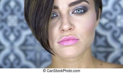 Closeup face of beautiful girl with silver smoky eye makeup...