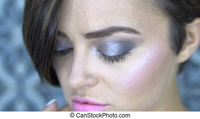 Closeup face of beautiful girl with silver smoky eye makeup...
