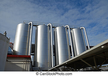 milk factory - storage silos for cleaning chemicals at a...