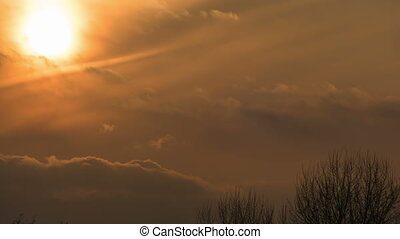 Sunset over the Trees and Clouds. Time lapse - Sunset over...