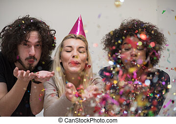 confetti party happy young people group celebrating new year...