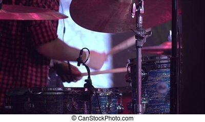musician plays drums on a stage 4k