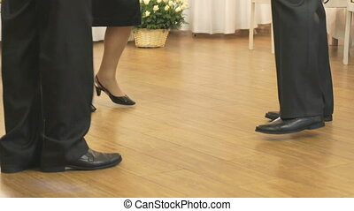Women's and men feet in moving close up - Women and men...